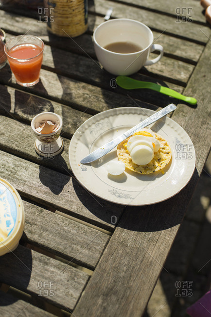 Outdoor breakfast with sliced boiled egg on a rice cake