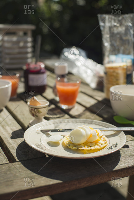 Breakfast served outdoors with sliced boiled egg on a rice cake