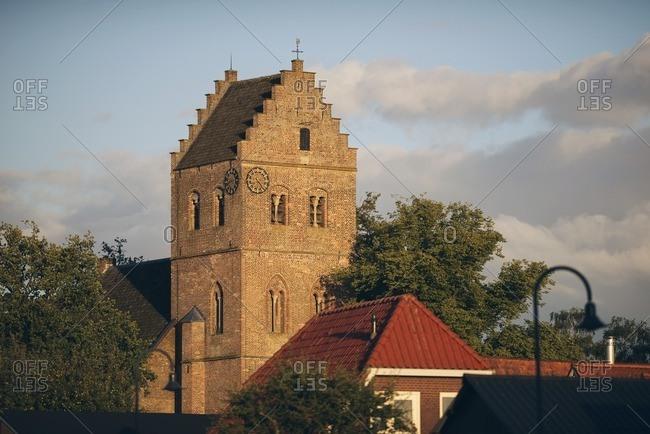 Ancient church between trees in sunlight, Geesteren, Achterhoek, Gelderland, The Netherlands