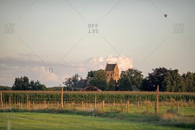 Skyline of old Dutch rural village with air balloon in the sky, Geesteren, Achterhoek, Gelderland, The Netherlands