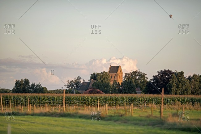 Skyline of old Dutch rural village with air balloon in the sky, Geesteren, Achterhoek, Gelderland, The Netherlands