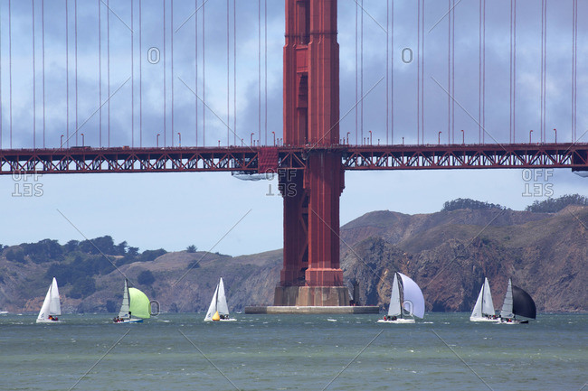 Sailboats in the bay beneath the Golden Gate Bridge