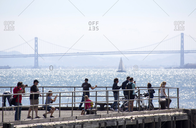 San Francisco, California - August 9, 2015: People standing at an overlook observing the Golden Gate Bridge
