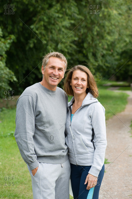 Mature couple wearing tracksuits