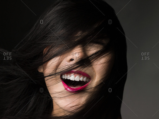 Woman with hair over her face