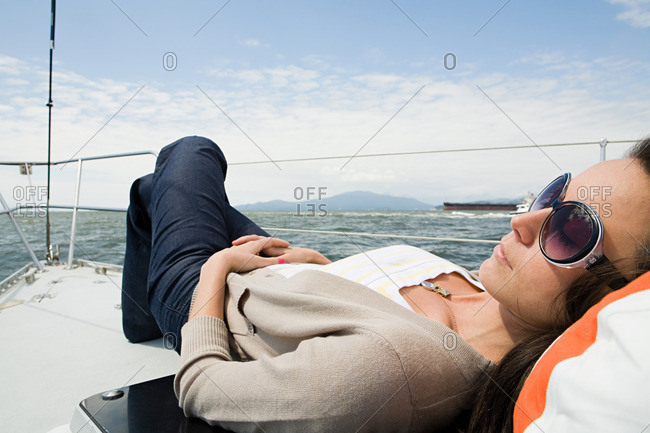 Woman sleeping on a sailboat