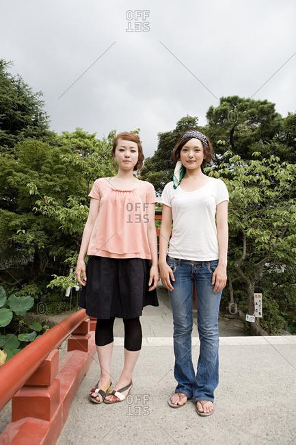 Young women in shrine garden