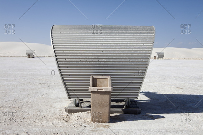 Trash bin behind a covered picnic table at the White Sands National Monument, New Mexico