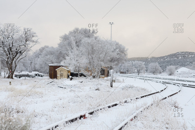 Lamy, New Mexico - December 13, 2011: Snow covered train tracks in Lamy New Mexico