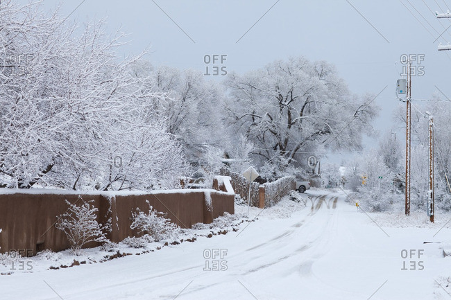 Lamy, New Mexico - December 13, 2011: Residential street covered in snow in Lamy, New Mexico