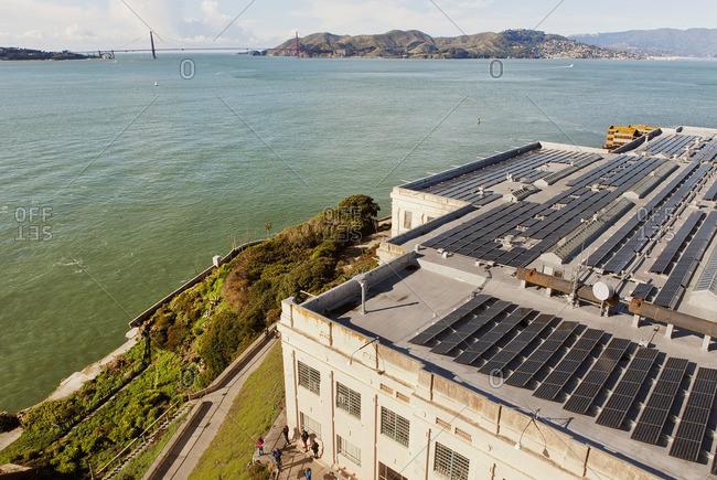 Overlooking the rooftop solar panels installed on top of one of the historic buildings at Alcatraz Island prison