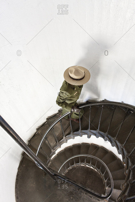 Park ranger walking up stairs in lighthouse at Alcatraz Island, California