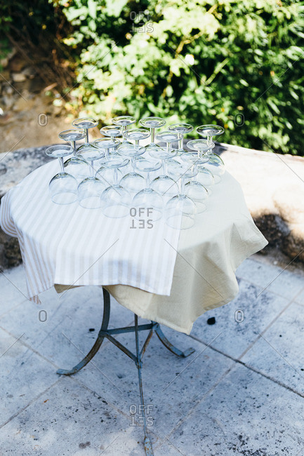 Wine glasses arranged upside down on table for party