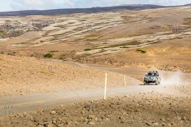 Kjolur highlands, Iceland - August 20, 2014: 4WD vehicle at speed on remote gravel road
