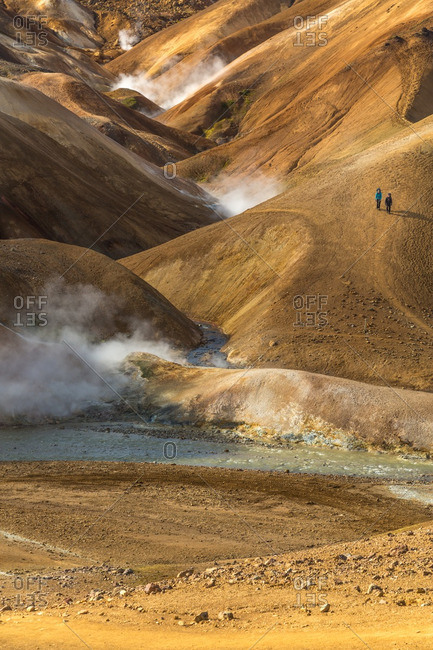People hiking in the Icelandic geothermal landscape in the remote Kjoslur highlands