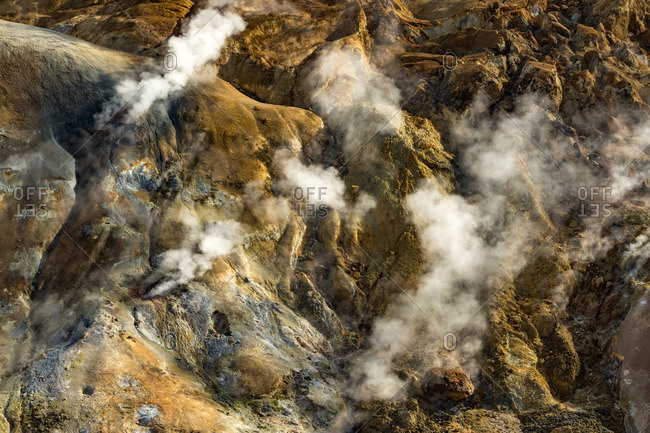 Steam rising from mountainside in Icelandic geothermal landscape in the remote Kjoslur highlands