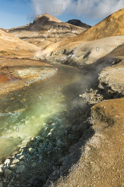 River and fumaroles in Icelandic geothermal landscape in the remote Kjoslur highlands
