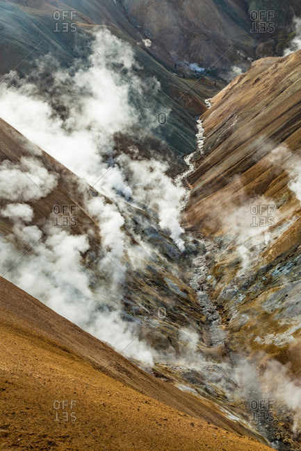 Steam rising from canyon in Icelandic geothermal landscape in the remote Kjoslur highlands