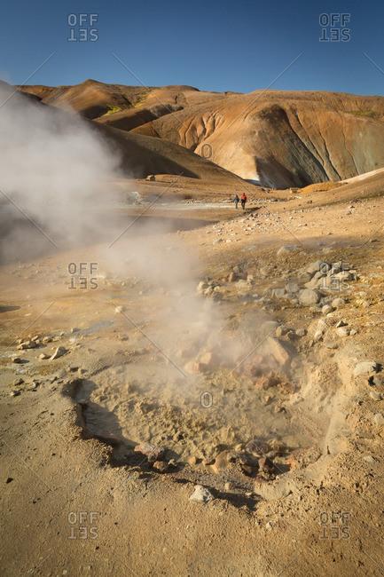 People hiking in Icelandic geothermal area in the remote Kjoslur highlands