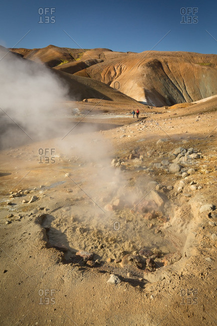 People hiking in Icelandic geothermal area in the remote Kjoslur highlands