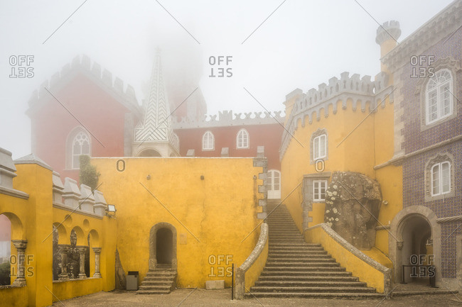 Palacio National (National Palace) da Pena on a foggy day in Lisbon, Portugal