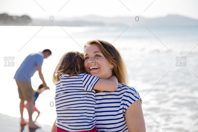 Family spending time together along a beach