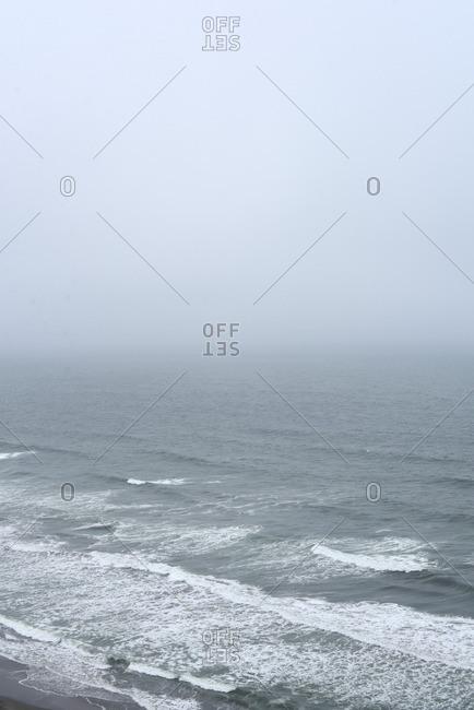 Overlooking gray ocean waves