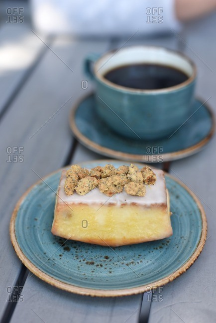 Cup of coffee and cake with crumb topping