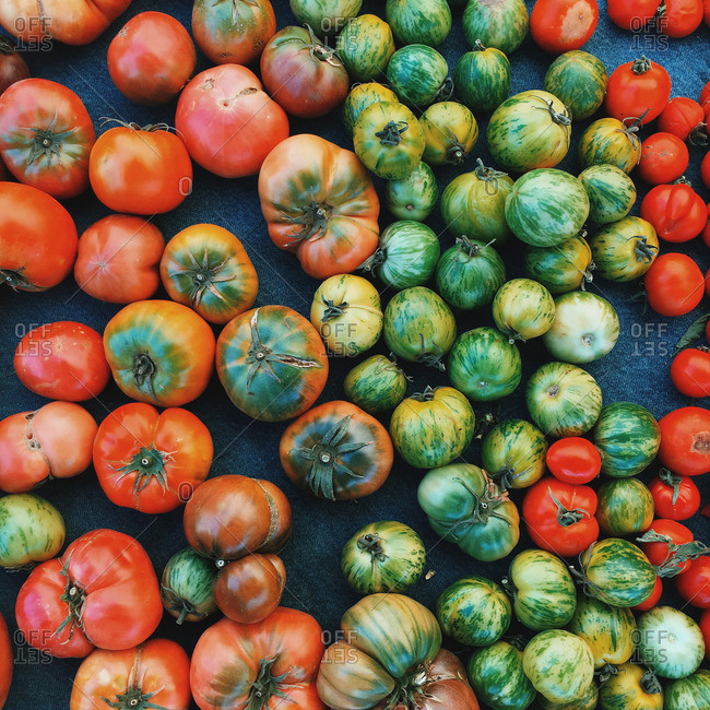 Overhead view of fresh heirloom tomatoes at market