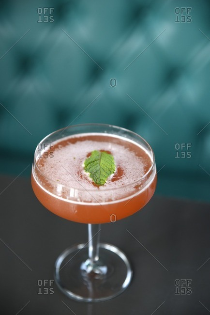 Champagne cocktail with mint leaf