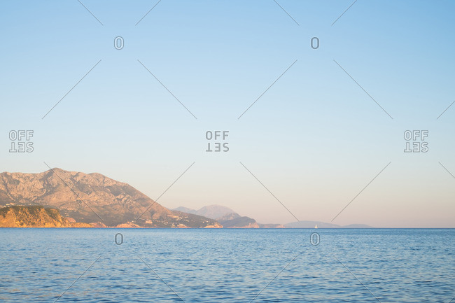 Scenic view of a bay with mountains in the distance