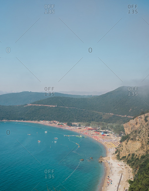 View of a bay, sandy beach, and resort