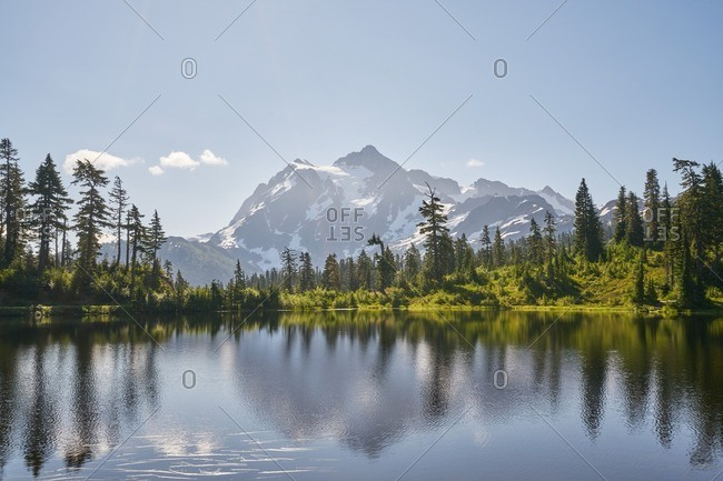 Reflection of Mount Baker-Snoqualmie National Forest in a lake, Washington