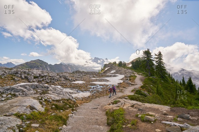 Couple hiking on trail at Mount Baker-Snoqualmie National Forest, Washington