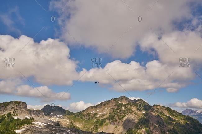 Helicopter flying over Mount Baker, Washington