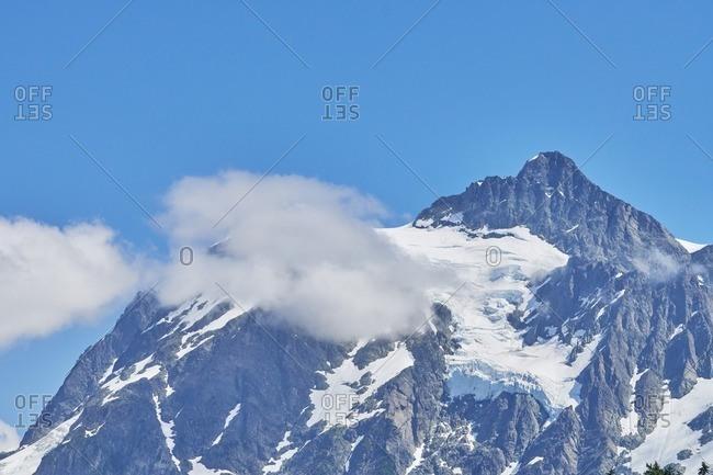 Clouds around a snowy peak of Mount Baker, Washington