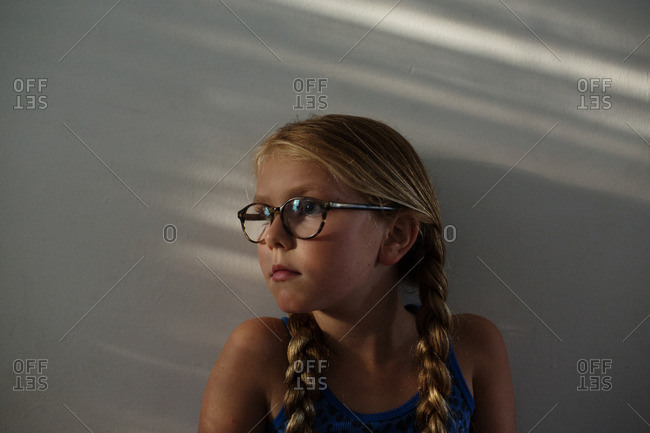 Little blonde girl with pigtails and glasses