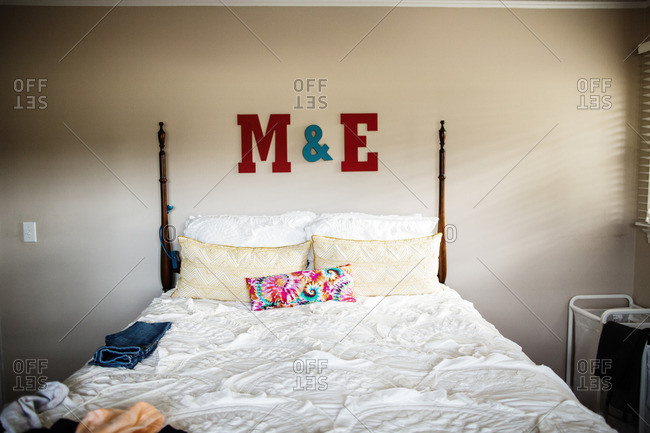 Master bedroom with M & E decorations above headboard