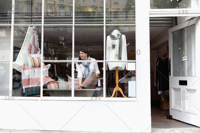 Shop owner arranging window display