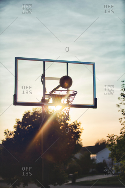 Basketball about to drop through basketball hoop