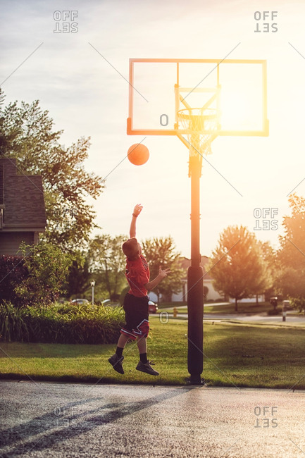 Boy shooting a basketball hook shot