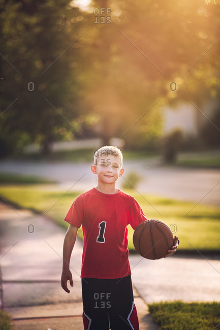 Portrait of young boy holding basketball