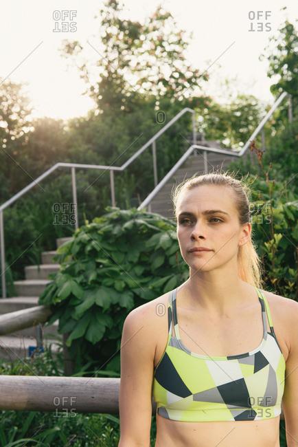 Portrait of young woman wearing sports clothing, Brooklyn Bridge Park, Brooklyn, New York, USA