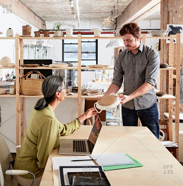 Man showing colleague ceramic samples
