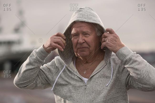 Man wearing hooded top looking at camera