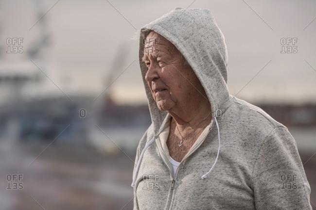 Man wearing hooded top looking away