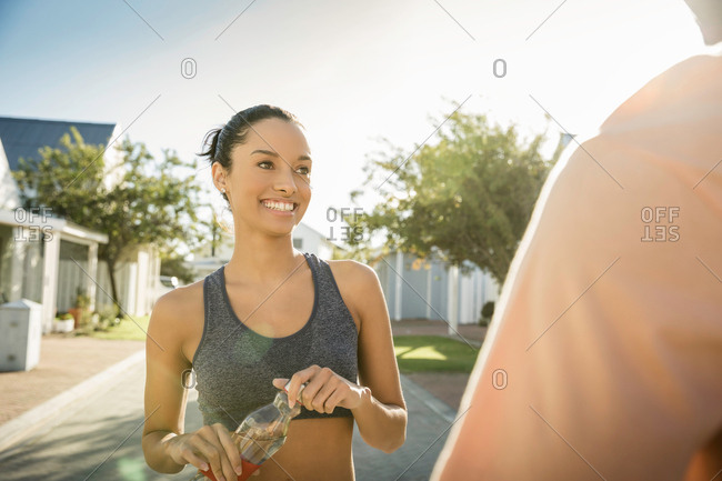 Woman in residential area smiling at friend