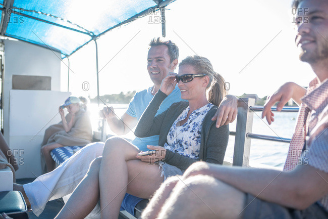 Tourist couple relaxing on boat trip, Cape Town, South Africa