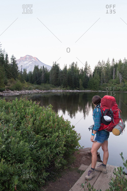 Young female hiker looking out to lake, Mount Hood National Forest, Oregon, USA