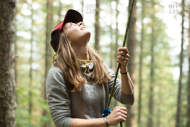 Young female climber holding climbing rope in forest, Mount Hood National Forest, Oregon, USA